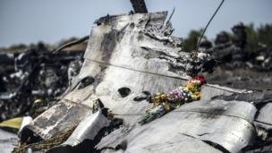 Security officials in Ukraine say the Malaysia Airlines jet downed in eastern Ukraine suffered an explosive loss of pressure caused by missile shrapnel.