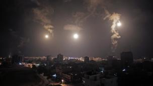 "Israeli PM Benjamin Netanyahu warns of a ""prolonged"" military campaign in Gaza, amid one of the most intense nights of shelling in the conflict."