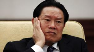 "China's former security chief Zhou Yongkang has been placed under investigation for ""serious disciplinary violation"", state media say."