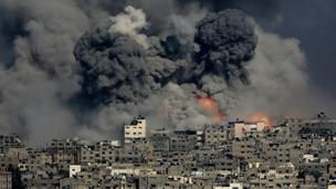 More than 100 Palestinians die, officials say, as Israel intensifies its Gaza bombardment and warns of a long conflict ahead.