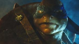 Paramount Pictures apologises over a Teenage Mutant Ninja Turtles poster, featuring the characters jumping from an exploding skyscraper alongside the release date of 11 September.