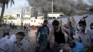At least 15 people are killed and 160 hurt as an Israeli strike hits a market crowded with shoppers near Gaza City, Palestinian officials say.