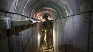 "Israel is ""determined"" to destroy all militant tunnels from Gaza ""with or without a ceasefire"", Prime Minister Benjamin Netanyahu says."