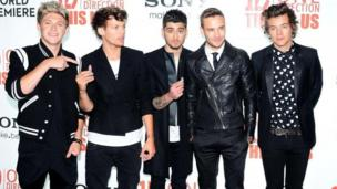One Direction's Midnight Memories was the biggest-selling album around the world in 2013, beating Eminem into second place, figures show.