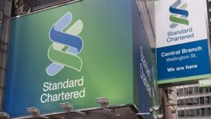 British bank Standard Chartered has agreed to pay $300m to New York's top banking regulator for failing to improve money laundering controls.
