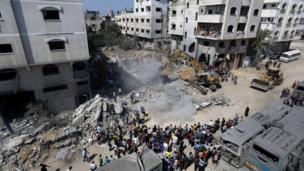 Hamas says militant chief Mohammed Deif is alive and leading its response to Israeli air strikes that killed 19 people in Gaza, including his wife and child.
