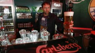 Sales at the Danish brewer Carlsberg have been hit by falling consumption in Russia and Ukraine amid the crisis in the region.