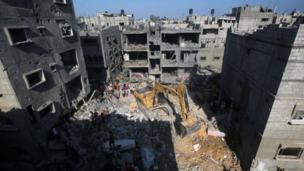 "An Israeli air strike kills three senior Hamas military commanders as Israel vows to pursue its Gaza campaign until it achieves ""full security""."