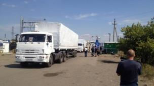 "Lorries from a Russian aid convoy stream into Ukraine without permission after Russia accuses Ukraine of ""intolerable"" obstructions."
