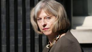New powers to fight extremist groups are being brought forward by the government, the home secretary confirms, as she defends its current counter-terrorism strategy.