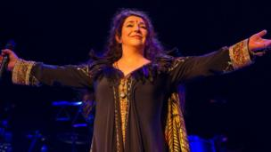 Kate Bush makes her stage comeback at London's Hammersmith Apollo to an ecstatic response from fans at her first live concert for 35 years.