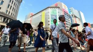Japan's economy shows signs of stagnation and weakness as households spent less and factory output stays flat in July.