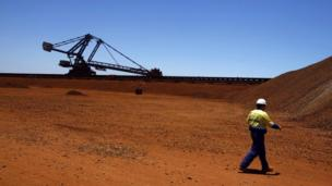 Australia scraps a controversial mining tax after the government strikes a deal with business tycoon Clive Palmer's political party.