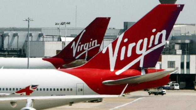 Virgin Atlantic sheds about 500 managerial and support jobs just months after the airline announced a return to profit.