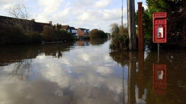 Belief in the reality of climate change has risen among the British public, partly because of the 2013 winter floods, according to a report.