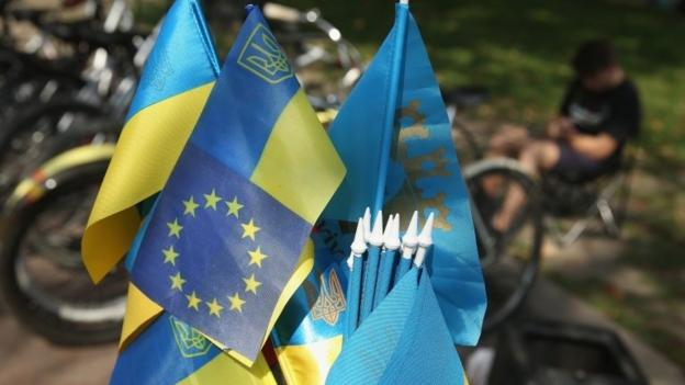 Ukraine's lawmakers are set to ratify a landmark EU association agreement, but the implementation of a free trade deal is delayed.