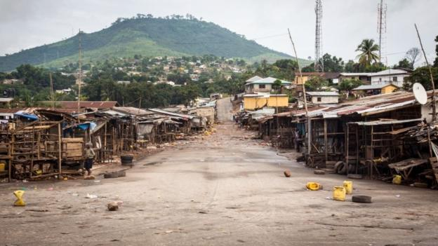 A three-day curfew is under way in Sierra Leone to enable health workers to find and isolate cases of Ebola, but critics warn it will achieve little.