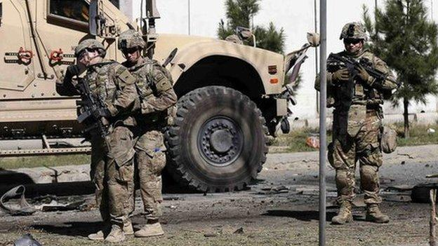 The new Afghan government signs a security deal with American officials that will allow US troops to remain in the country beyond 2014.