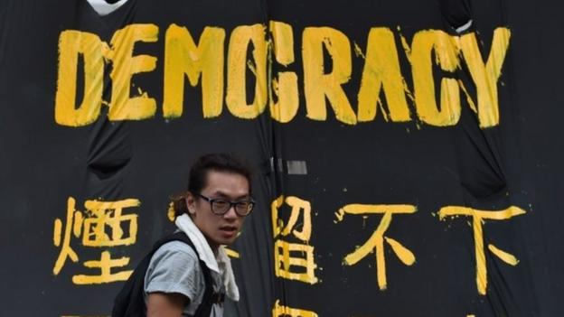 "Hong Kong leader CY Leung urges pro-democracy protesters to ""immediately"" stop their campaign, as crowds bring areas to a standstill."