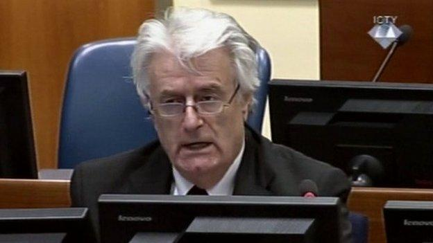 "Radovan Karadzic sums up his defence saying he takes ""moral responsibility"" for crimes committed by Bosnian Serbs but denying he ordered killings."