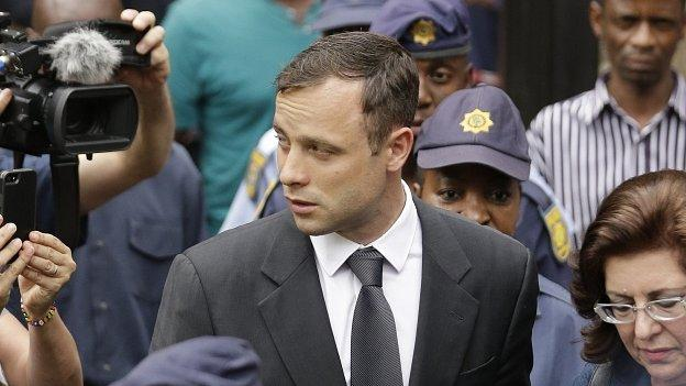 Oscar Pistorius' siblings describe their heartache and criticise media coverage of his trial, on the eve of the South African athlete's sentencing.