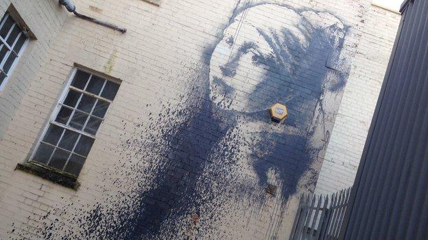 A new mural by street artist Banksy in Bristol is vandalised less than 24 hours after the work appeared.