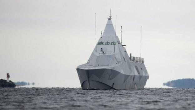 Naval vessels scouring Swedish waters for a suspected foreign submarine focus on a bay near Stockholm on the fifth day of their search.