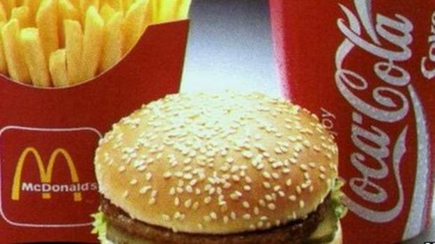 McDonald's and Coca Cola post profits down sharply in the three months to the end of September, with both seeing sales under pressure in the US.
