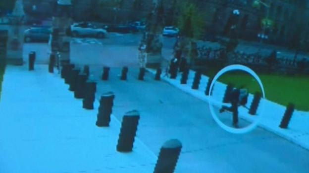Authorities in Canada release video showing the moments before a lone gunman stormed into Canada's parliament and was shot dead.