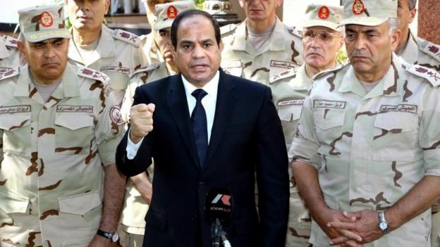 Egypt faces an existential threat from jihadists, the president says, after at least 31 soldiers are killed in two attacks in the Sinai peninsula.