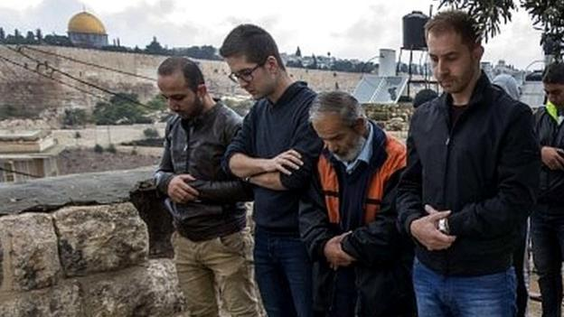 Israel reopens a key Jerusalem holy site after its temporary closure following the shooting of a prominent Jewish activist.