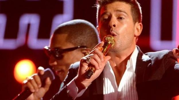 A US judge rules the long-running dispute between Marvin Gaye's family, Robin Thicke and Pharrell Williams over claims of plagiarism should go to trial.
