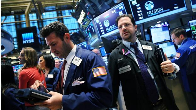 US stocks close at yet another record high after China announced a surprise rate cut and the head of the European Central Bank hinted at further stimulus action.