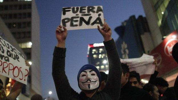 Relatives of 43 missing Mexican students, who the authorities say were murdered by a drugs gang, lead mass protests in the capital city.
