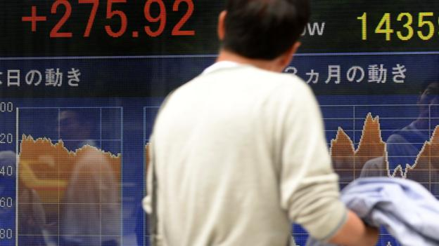 Asian stock markets traded higher as investors cheer an interest rate cut in China and the European Central Bank's vow to fight deflation.