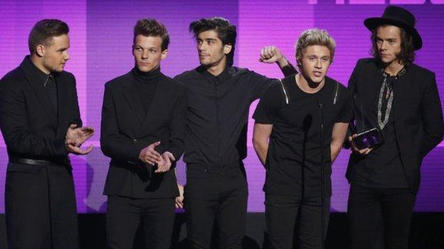 See all the pictures from the American Music Awards as Katy Perry and One Direction both take home three trophies each.