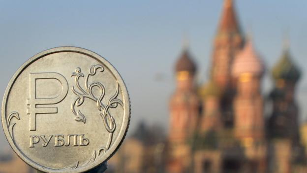 The falling oil price is costing Russia up to $100bn a year, while Western sanctions have hit the country by a further $40bn, its finance minister says.