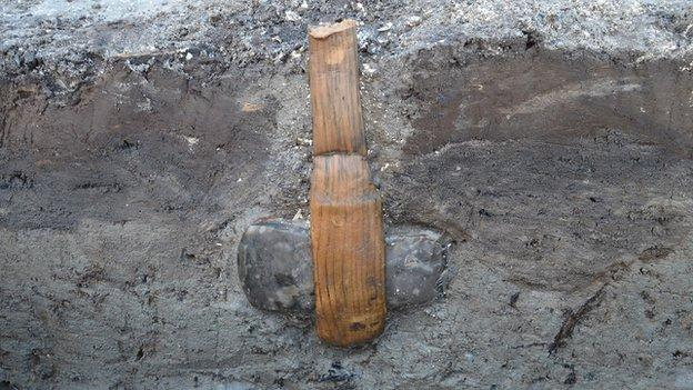Archaeologists in Denmark have uncovered an incredibly rare find: a stone age axe held within its wooden handle.