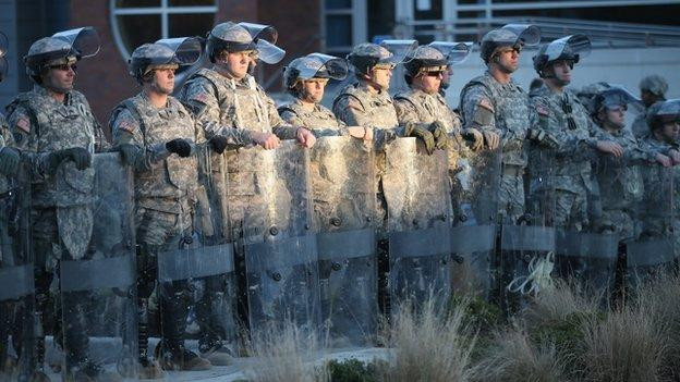 The US state of Missouri orders 2,200 National Guardsmen to Ferguson to quell unrest after a police officer was cleared over the killing of Michael Brown.