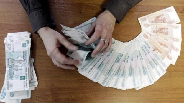 Russia says it is planning new measures to stabilise the rouble after its slump against the dollar.