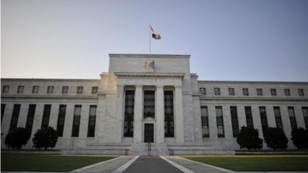"The US Federal Reserve leaves interest rates on hold and says it ""can be patient"" over any decision to raise them, sending stocks higher."