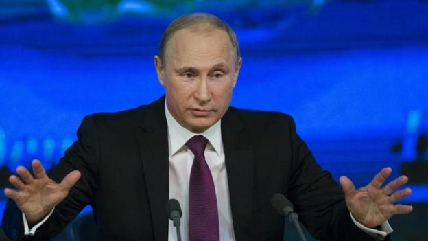 President Vladimir Putin insists Russia's under-fire currency will stabilise, but warns the country's economic crisis could last two years.