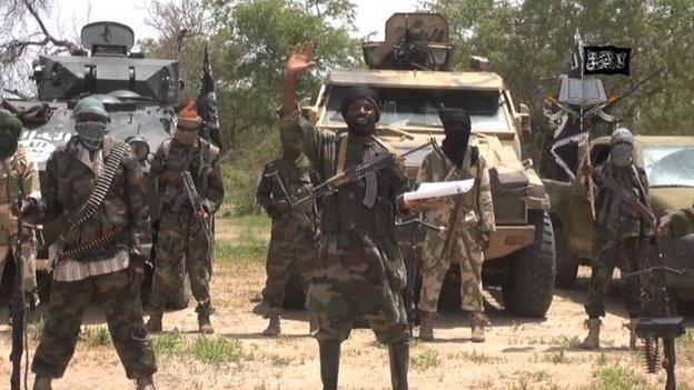 Militants storm a remote village in north-eastern Nigeria, killing at least 33 people and kidnapping at least 100, a survivor tells the BBC.