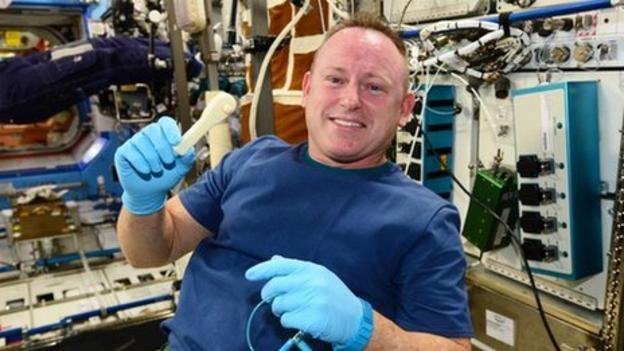 Astronauts on the International Space Station use a 3-D printer to make a wrench from instructions sent up in an email.