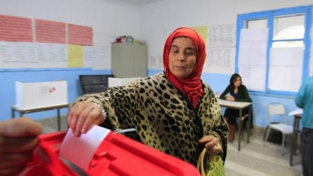 Tunisia, whose 2011 uprising inspired the Arab Spring, holds a presidential run-off with the winner becoming the country's first freely elected leader.