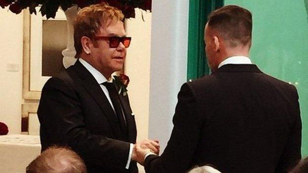 Sir Elton John and his partner David Furnish convert their civil partnership to a marriage - with the musician documenting the day on the Instagram website.
