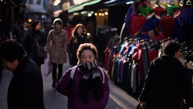 Asia's fourth largest economy, South Korea, cuts its growth forecast for this year and next as consumer and business sentiment weakens.