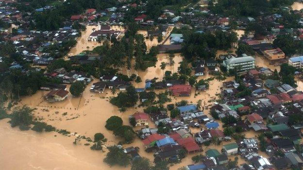 Malaysia is battling some of the worst floods in decades along its east coast, with more than 100,000 people forced to leave their homes.