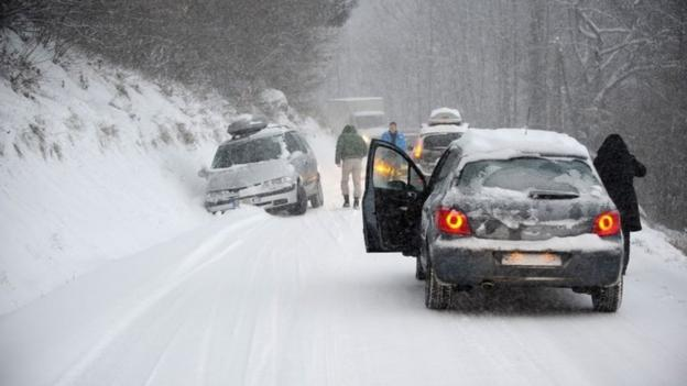 Snow and ice strand 15,000 vehicles in the French Alps, snarling up holiday traffic to and from ski resorts.