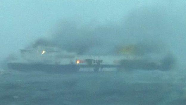 A Greek ferry which caught fire on route to Italy with 478 people on board is being evacuated amid choppy seas and high winds.